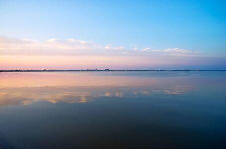 saki: Clouds reflected in the waters of Saki salt lake . Crimea . Stock Photo