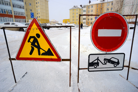 informational: Road signs prohibiting passage when clearing snow in the yards.