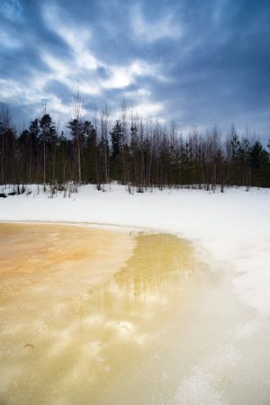 thawed: Spring landscape with a brook and snow in the woods . Siberia, Yugra. Stock Photo
