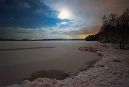 Winter night landscape with the moon. Stock Photo