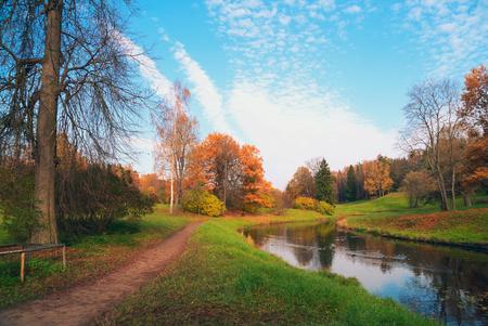Bank of the Slavyanka river in Pavlovsk Park. Autumn landscape.