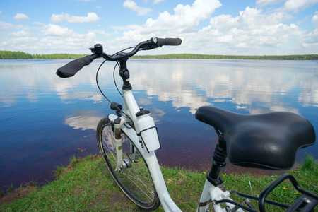 The bike is on the lake on a Sunny summer day.