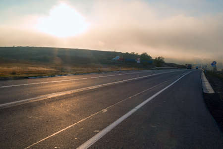 Route A-270 in the area of Novoshakhtinsk in the early morning in the fog. Russia.