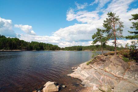 Rocky shore of the island on the lake . Ladoga Skerries, Karelia