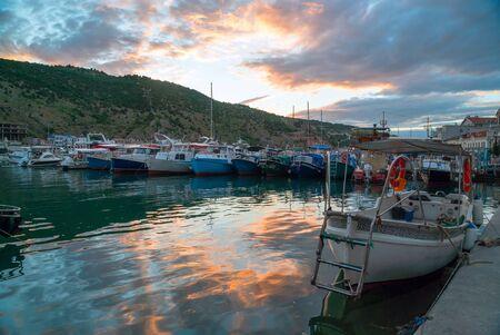 Boats and boats at the pier at sunset . Balaklava, Crimea
