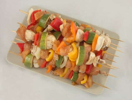 Grilled meat and vegetable kebab  Фото со стока