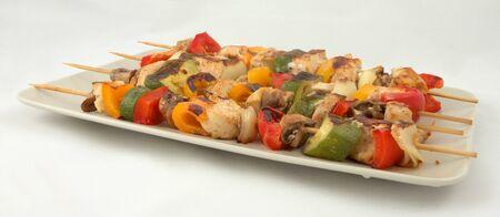 Meat and vegetable kebab  Фото со стока