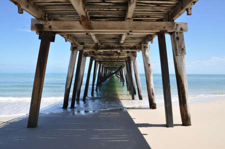 Underneath the Grange Jetty in sunny South Australia taken at noon as the morning tide subsides