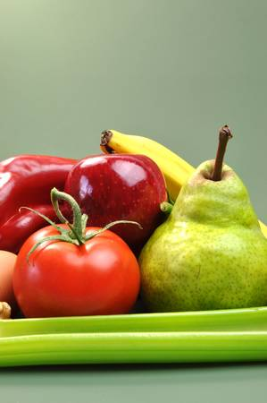 heathy diet: Group of wholesome, organic food, including pear, apple, tomato, eggs, nuts, pecans, walnuts, carrot, banana, and apple, for a healthy diet or slimming New Year resolution  Stock Photo