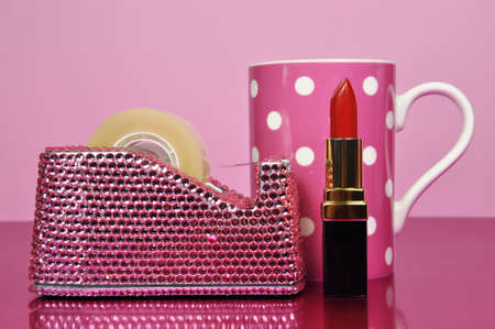 ladylike: Pretty pink bling office accessories and iconic female symbols.