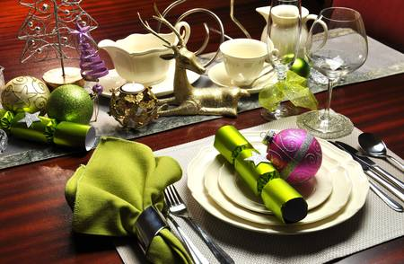 Christmas Eve dinner table setting with modern lime green and pink accents