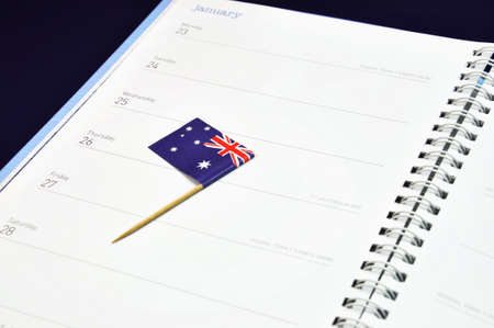 downunder: Australia Day January 26, Australian flag placed in journal diary marking the day  Stock Photo
