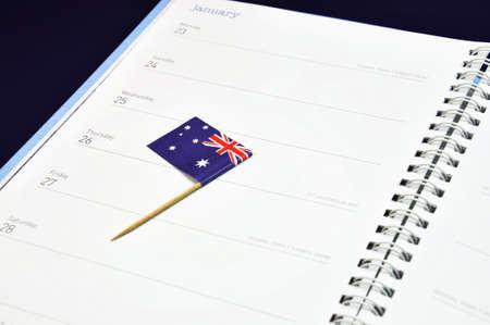 tucker: Australia Day January 26, Australian flag placed in journal diary marking the day  Stock Photo