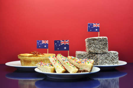 tucker: Australia Day January 26, celebrate with tradional Aussie tucker food such as lamingtons, meat pies and tomato sauce, and yummy fairy bread  Stock Photo