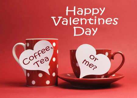 Flirty Happy Valentine Day message with  Coffee, Tea or Me   message written on white heart sign tags on red and white polka dot coffee mug and tea cup, against a red background