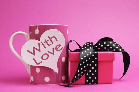 cute love: Cute and sassy pink mug and gift with polka dot ribbon on pink background