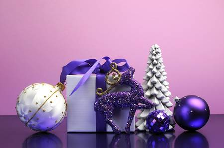 Purple theme Christmas tree, gift and bauble decorations festive holiday still life  photo