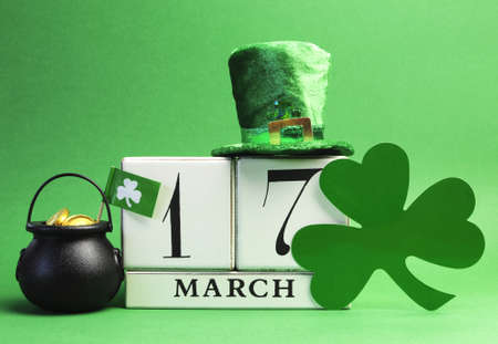 Save the date white block calendar for St Patrick s Day, March 17, with leprechan hay, pot of gold and shamrock  photo