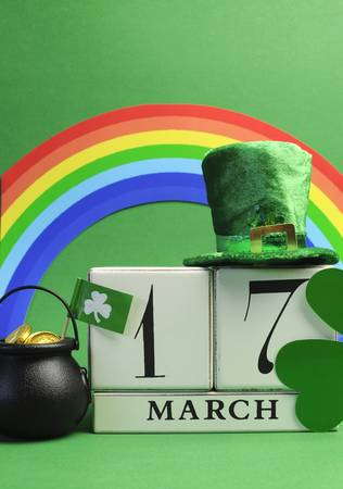 st  patrick s day: Save the date white block calendar for St Patrick s Day, March 17, and rainbow - vertical  Stock Photo