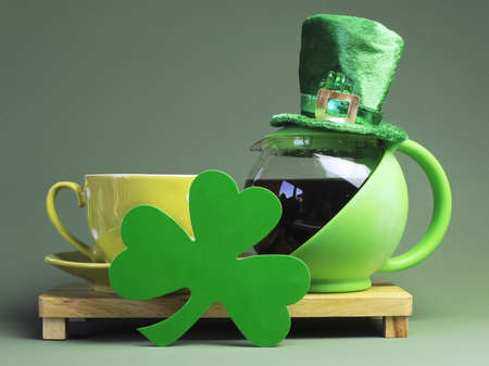 St Patrick s Day breakfast with green tea pot of coffee, leprechaun hat and shamrock  photo