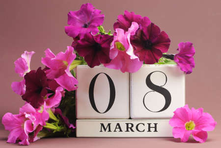 womens day: Save the date white block calendar for International Women, with pink and purple flowers on pink purple background