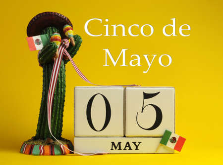 Save the date white block calendar for Cinco de May, May 5, with fun Mexican cactus and flags against a yellow background