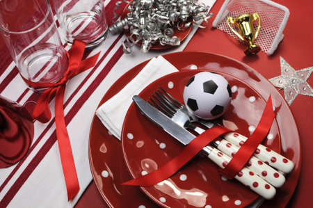 Soccer football celebration party table settings in red and white team colors  photo