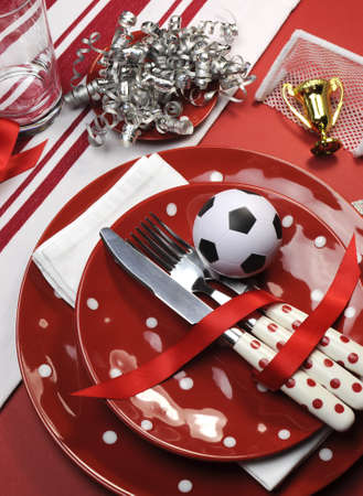 portrait orientation: Soccer football celebration party table settings in red and white team colors  Vertical portrait orientation  Stock Photo
