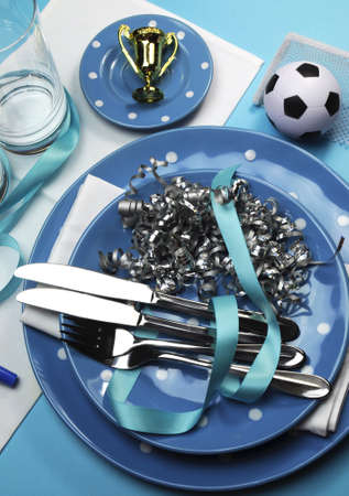 chelsea: Soccer football celebration party table settings in light  sky  blue and white team colors  Vertical portrait orientation  Stock Photo