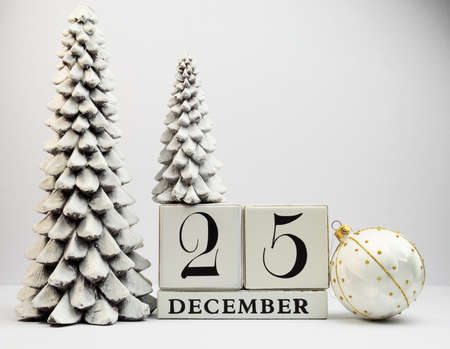 White theme, save the date white block calendar for Christmas Day, December 25, with Christmas trees and baubles  photo