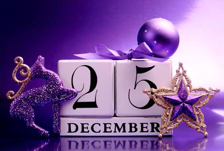 Purple theme Save the Date white block calendar for Christmas Day, December 25, with colorful festive decorations  photo