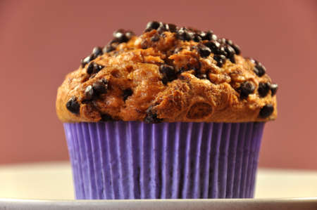 pastry shop: Chocolate Chip Muffin on a stone plate for a delicious treat, snack or fancy food serving at home or in a restaurant, at coffee break time