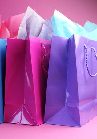 retail therapy: Retail therapy, I love shopping, concept with colorful shopping bags against a pink background, vertical side view  Stock Photo