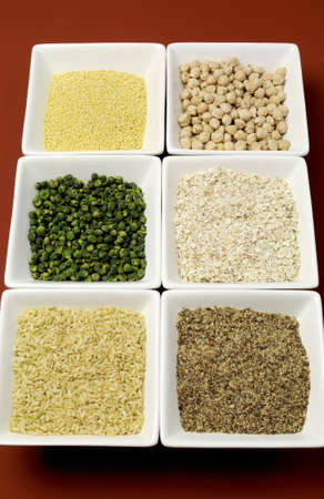 celiac disease: Gluten free grains food - brown rice, millet, LSA, buckwheat flakes and chickpeas and green peas legumes - for a healthy diet free of celiac disease  Vertical  Stock Photo