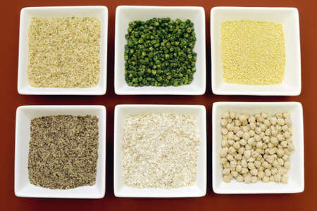 celiac disease: Gluten free grains food - brown rice, millet, LSA, buckwheat flakes and chickpeas and green peas legumes - for a healthy diet free of celiac disease  Close-up