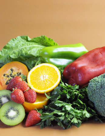 naturopath: Sources of Vitamin C - oranges, strawberries, red and green capsicum peppers, dark leafy green, parsley, broccoli, paw paw and kiwi fruit - for healthy diet and slimming program  Vertical with copy space  Stock Photo