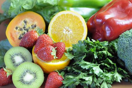 naturopath: Sources of Vitamin C - oranges, strawberries, red and green capsicum peppers, dark leafy green, parsley, broccoli, paw paw and kiwi fruit - for healthy diet and slimming program  Close-up