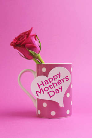 mothering: Happy Mothers Day heart gift tag on pink polka dot coffee mug with pink rose bud