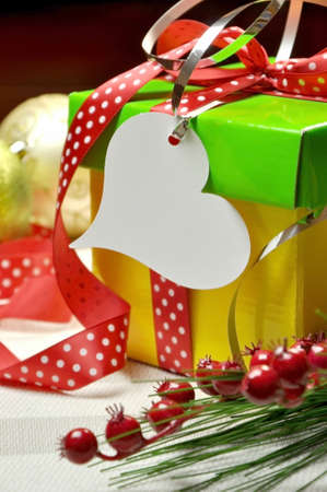 Bright Modern Red, Green and Yellow Christmas Present Closeup with heart gift tag  photo