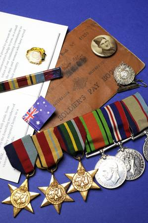 remembrance: WWII Australian military army corps medals and memorabillia for ANZAC Day April 25, Remembrance Day November 11, or Australian military - vertical
