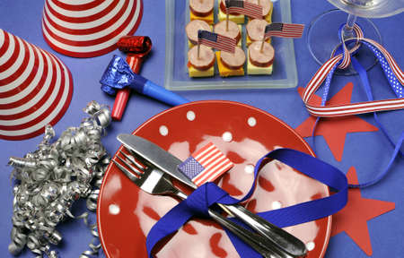 USA Happy Fourth 4th of July party table setting with flags, ribbons, polka dots, and stars and stripes decorations  Stock Photo - 18909089