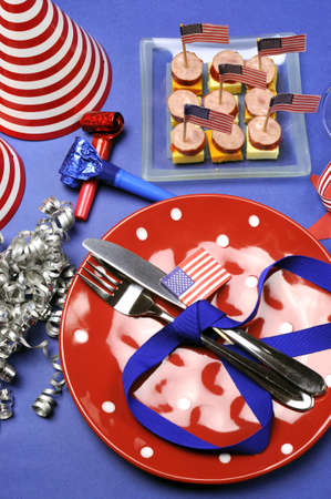 USA Happy Fourth 4th of July party table setting with flags, ribbons, polka dots, and stars and stripes decorations  Vertical Stock Photo - 18909103
