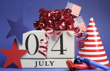 Fourth of July celebration, save the date white block calendar with stars and stripes, flags, and party decorations in USA America style red white and blue Stock Photo - 18909125