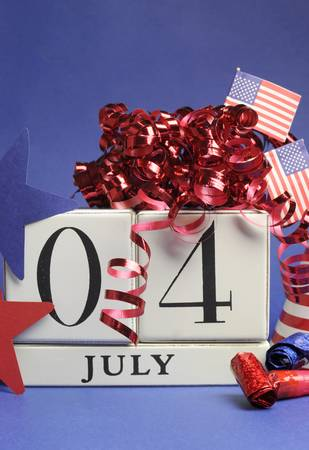 Fourth of July celebration, save the date white block calendar with stars and stripes, flags, and party decorations in USA America style red white and blue - vertical  photo
