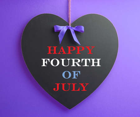 Fourth of July, USA America holiday, celebration with Happy Fourth of July message on heart shape blackboard in red, white and blue colors  photo