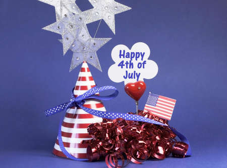 Happy Fourth 4th of July party table decorations with hat, streamers, sign, flag and stars in USA America red, white and blue theme. Stock Photo - 18909099