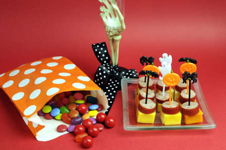 Happy Halloween party food with skeleton hand glass on red background. Stock Photo - 19056976