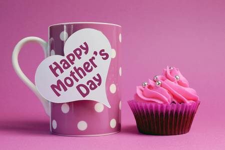 sensational: Happy Mothers Day message on white heart tag with pink polka dot coffee mug and pink cupcake