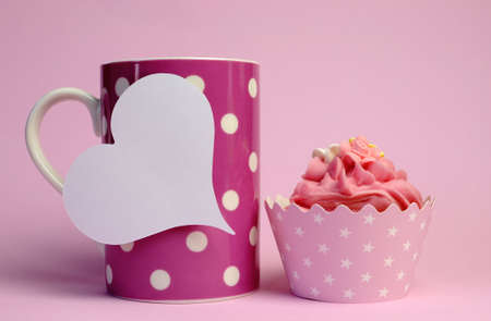 topper: Pink polka dot coffee mug with pink cupcake and blank white heart shape gift tag for your text here, for female birthday, mothers day, or special occasion event.