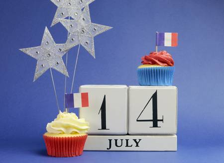 fourteenth: France National holiday calendar, 14 July, Fourteenth of July, Bastille Day, with flags , cakes and stars decorations. Stock Photo